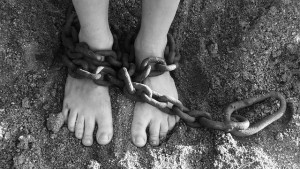 Feet shackled in chains